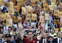 Calcio, Serie A: Roma, stadio Olimpico, 28 maggio 2017.<br /> AS Roma's Francesco Totti holds a framed Number 10 during a ceremony to celebrate his last match with AS Roma after tduring the Italian Serie A football match between AS Roma and Genoa at Rome's Olympic stadium, May 28, 2017.<br /> Francesco Totti's final match with Roma after a 25-season career with his hometown club.<br /> UPDATE IMAGES PRESS/Isabella Bonotto