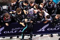 28th March 2021; Sakhir, Bahrain; F1 Grand Prix of Bahrain, Race Day;   HAMILTON Lewis gbr, Mercedes AMG F1 GP W12 E Performance, celebrates his win with his team after Formula 1 Gulf Air Bahrain Grand Prix