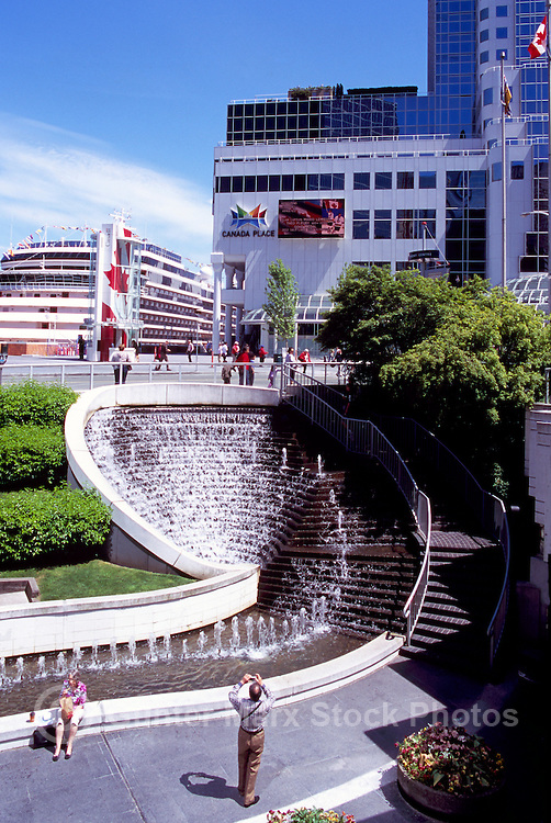 """Water Fountain at """"Waterfront Centre"""" overlooking Cruise Ship docked at """"Canada Place"""" Trade and Convention Centre and Cruise Ship Terminal, Vancouver, British Columbia, Canada"""