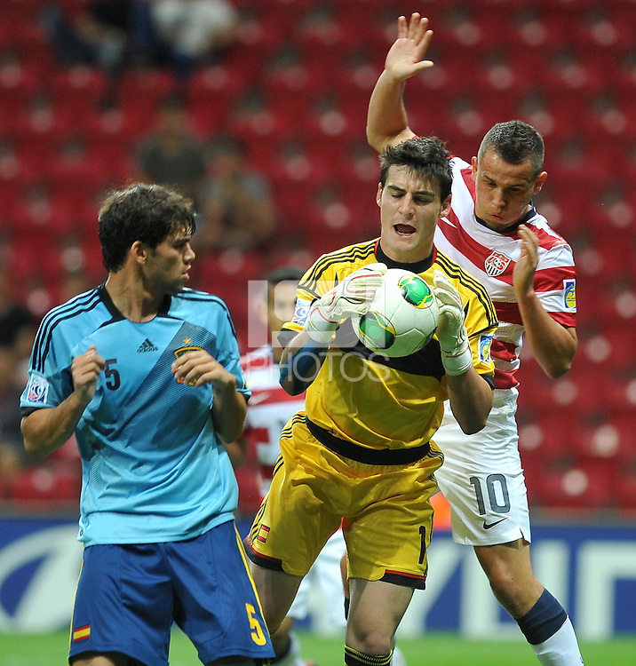 Spainish U20 Israel Puerto (L) and Goal Keeper Daniel Sortes (C) battle USA U20 Luis Gil (R) during their FIFA U-20 World Cup Turkey 2013 Group Stage Group A soccer match USA U20 betwen Spain at the Kadir Has stadium in Kayseri on June 21, 2013. Photo by Aykut Akici/isiphotos.com