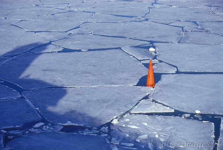 Buoy and ship's shadow in winter ice mosiac- Archipelago Sea, Finland