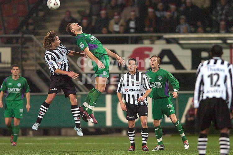 heracles - groningen 22-12-2006 eredivisie seizoen 2006-2007   levchenko wint kopduel van maas