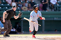 Shortstop Ezequiel Duran (17) of the Hickory Crawdads in a game against the Greenville Drive on Sunday, August 29, 2021, at Fluor Field at the West End in Greenville, South Carolina. The umpire is Mitch Leikam. (Tom Priddy/Four Seam Images)