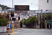 People wait at the Willis St and Terrace Tunnel intersection during Alert Level 2 COVID-19 pandemic civil emergency conditions in Wellington, New Zealand on Saturday, 16 May 2020. Photo: Dave Lintott / lintottphoto.co.nz