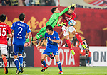 Goalkeeper Yapp Hung Fai of Eastern SC competes for the ball with Yu Hanchao (r) of Guangzhou Evergrande FC during their AFC Champions League 2017 Match Day 1 Group G match between Guangzhou Evergrande FC (CHN) and Eastern SC (HKG) at the Tianhe Stadium on 22 February 2017 in Guangzhou, China. Photo by Victor Fraile / Power Sport Images