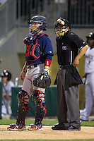 Lehigh Valley IronPigs catcher Koyie Hill (23) and home plate umpire Brad Myers wait for the game against the Charlotte Knights to resume at BB&T Ballpark on May 8, 2014 in Charlotte, North Carolina.  The IronPigs defeated the Knights 8-6.  (Brian Westerholt/Four Seam Images)