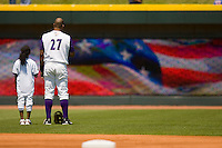 Ozzie Lewis #27 and a young fan during the National Anthem at  BB&T Ballpark May 9, 2010, in Winston-Salem, North Carolina.  Photo by Brian Westerholt / Four Seam Images