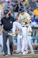 Vanderbilt Commodores outfielder Pat DeMarco (18) stomps on the plate after hitting a home run against the Michigan Wolverines during Game 3 of the NCAA College World Series Finals on June 26, 2019 at TD Ameritrade Park in Omaha, Nebraska. Vanderbilt defeated Michigan 8-2 to win the National Championship. (Andrew Woolley/Four Seam Images)