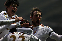 Saturday 19 January 2013<br /> Pictured: Ben Davies of Swansea (C) celebrating his opening goal with team mates Michu (R) and Ki Sung Yueng (L).<br /> Re: Barclay's Premier League, Swansea City FC v Stoke City at the Liberty Stadium, south Wales.