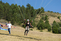 Saint Vincent-les-Forts, Lac de Serre Poncon, France, September 2007. Instructor  Roland ter Harkel guides a student into the air. Volantis is home to the paragliding school Inferno. In one week time, students learn to fly the paraglider and earn their mountain licence 1. Photo by Frits Meyst/Adventure4ever.com