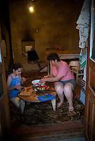 REPUBLIC OF MOLDOVA, Gagauzia, Tomai, 2009/07/1..Maia, 12 years old, and her mother Maria, cook dinner on a table typically Gagauz..© Bruno Cogez / Est&Ost Photography..REPUBLIQUE MOLDAVE, Gagaouzie, Tomai, 1/07/2009..Maia, 12 ans, et sa mère Maria, préparent le dîner sur une table typiquement gagaouze..© Bruno Cogez / Est&Ost Photography