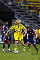 25 OCTOBER 2009:  Sainey Nyassi of the New England Revolution (31), Kheli Dube and Steven Lenhart of the Columbus Crew (32) during the New England Revolution at Columbus Crew MLS game in Columbus, Ohio on October 25, 2009.