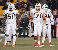 Miami defensive linemen Shayon Green (51), Anthony Chickillo (71) and Curtis Porter (96).The Miami Hurricanes defeated the Pitt Panthers 41-31 at Heinz Field, Pittsburgh, Pennsylvania on November 29, 2013.
