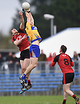 Jonathan Flynn of  Down in action against Gary Brennan of Clare during their Division 2, Round 2 National League game at Cusack Park. Photograph by John Kelly.