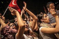Protesters shout slogans as they gather at night all over Gazi park of Taksim Square during a 24/7 masive rally against the turkish government in Istanbul, Turkey.
