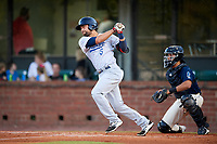 Pensacola Blue Wahoos shortstop Alex Blandino (5) follows through on a swing in front of catcher Francisco Arcia (32) during a game against the Mobile BayBears on April 25, 2017 at Hank Aaron Stadium in Mobile, Alabama.  Mobile defeated Pensacola 3-0.  (Mike Janes/Four Seam Images)
