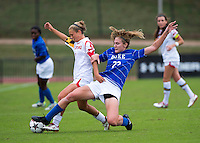 Riley Barger (10) of Maryland has the ball tackled away from her by Malinda Allen (22) of Duke at Ludwig Field on the campus of the University of Maryland in College Park, MD. DC. Duke defeated Maryland, 2-1.