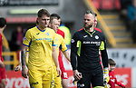 Aberdeen v St Johnstone…31.03.18…  Pittodrie    SPFL<br />Alan Mannus and Jason Kerr make their way onto the ptich<br />Picture by Graeme Hart. <br />Copyright Perthshire Picture Agency<br />Tel: 01738 623350  Mobile: 07990 594431