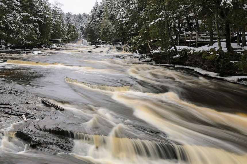 Looking upstream on the rugged and beautiful Presque Isle River in the Porcupine Mountains State Park. In the distance you can also see 25-foot Manabezho Falls.