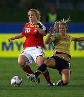 Leonie Maier (GER) is tackled by Courtney Verloo (USA)..FIFA U17 Women's World Cup, Semi Final, Germany v USA, QEII Stadium, Christchurch, New Zealand, Thursday 13 November 2008. Photo: Renee McKay/PHOTOSPORT
