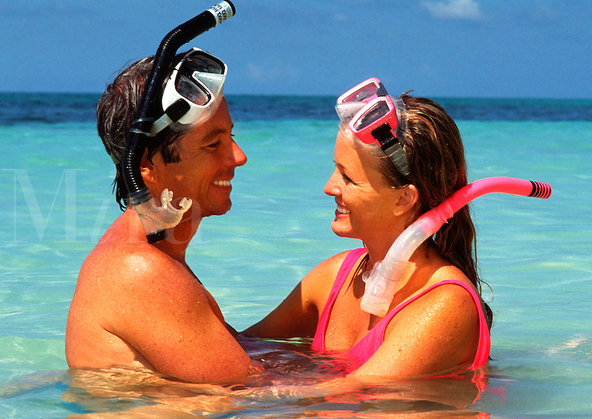 Snorkeling couple on the beach