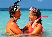 Snorkeling couple on the beach
