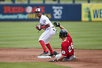 Samil Polanco (13) of the Kannapolis Cannon Ballers forces out Andre Nnebe (26) of the Carolina Mudcats at second base at Atrium Health Ballpark on June 13, 2021 in Kannapolis, North Carolina. (Brian Westerholt/Four Seam Images)