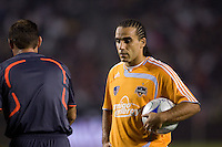 Houston Dynamo's Dwayne De Rosario takes the ball from referee Terry Vaughn for a PK. . The Houston Dynamo and Chivas USA played to a 1-1 tie at Home Depot Center stadium in Carson, California on Saturday October 25, 2008. Photo by Michael Janosz/isiphotos.com
