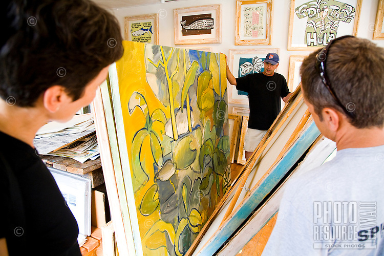 Tourists viewing paintings at Keokea Gallery in Kula, Maui