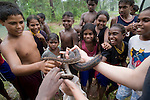 Lauren Collings, the local snake breeder from Weipa shows her pet spotted python (Antaresia maculosa) to the Aboriginal kids of Napranum Aboriginal community.