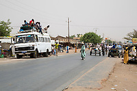 Senegal, Touba.  Local Transport and Traffic Safety.  Young Men will ride on top to the destination.
