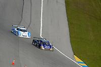 #39 Crown Royal Porsche/Coyote and #01 Ganassi Racing Lexus/Riley of Scott Pruett & Memo Rojas