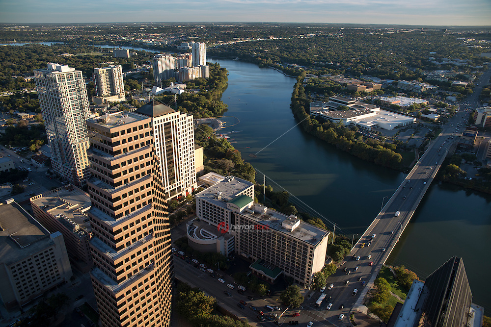 The skyline of Austin, Texas and Congress Ave. Bridge overlooking Lady Bird Lake from a high angle bird's-eye view.