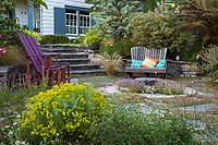 Shelagh Tucker front yard dry garden patio room with chairs,  Euphorbia 'Copton Ash' (Spurge), Seattle, Washington