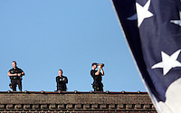 Security forces maintain a watchful eye from a rooftop above Democratic presidential nominee Sen. Barack Obama's campaign rally in downtown Des Moines, Friday, October 31, 2008, just four days before the general election.  Obama returned Iowa, where he won his first victory on his path to the nomination- the Iowa caucuses, eleven months before.