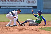 Asheville Tourists second baseman Forrest Wall (7) fields and puts a tag on a hard sliding Wander Franco (8) during a game against the Lexington Legends on May 3, 2015 in Asheville, North Carolina. The Legends defeated the Tourists 6-3. (Tony Farlow/Four Seam Images)