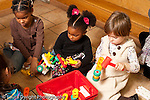 Education preschool 2-4 year olds group of girls playing with plastic hammers and construction toy horizontal