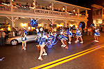 Cheerleaders from Amador High School perform in Sutter Creek's annual Parade of Lights Christmas parade downtown on a rainy night in the  Mother Lode of Calif.