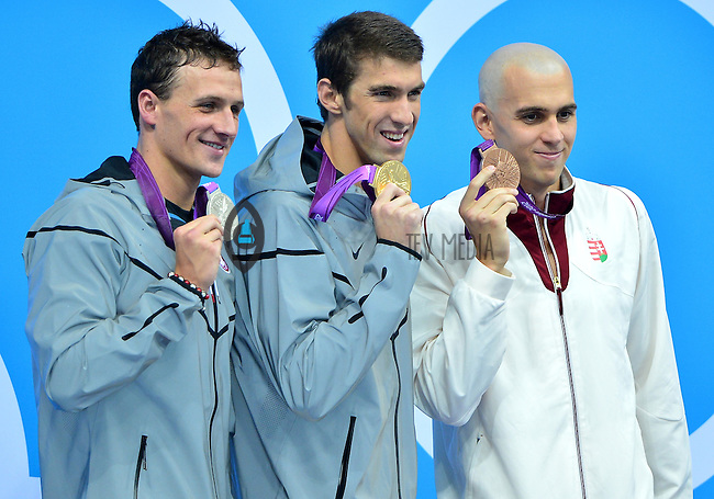 August 02, 2012..L to R: Ryan Lochte, Michael Phelps, Laszlo Cseh pose with their Medals during Award Ceremony for Men's 200m Individual Medley at the Aquatics Center on day six of 2012 Olympic Games in London, United Kingdom.
