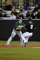 Siena Saints infielder Brian Fay (28) tags out Dylan Moore (2) during the opening game of the season against the UCF Knights on February 13, 2015 at Jay Bergman Field in Orlando, Florida.  UCF defeated Siena 4-1.  (Mike Janes/Four Seam Images)