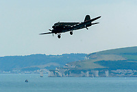 BNPS.co.uk (01202 558833)<br /> Pic: Graham Hunt/BNPS<br /> Date: 2nd September 2021.<br /> <br /> The Dakota of the Battle of Britain memorial flight in action with Old Harry Rocks in the distance on day 1 of Bournemouth Air Festival in Dorset on a warm overcast day.