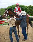15 APR -Jockey Ramon Dominguez receives congratulations from Larry Jones after riding Harve de Grace to victory in the 47th running of the Apple Blossom Handicap at Oaklawn Park in Hot Springs, Arkansas.