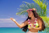 Part hawaiian young woman (wahine) near beach dancing modern hula (auana)