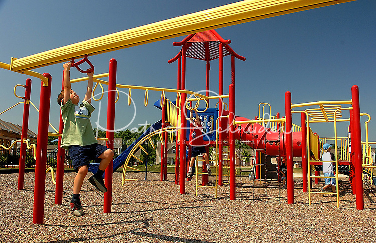 Children play on the playground  at Berewick master-planned community in southwest Mecklenburg County, Charlotte, NC. The property is developed by Pappas Properties.