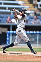 Charleston RiverDogs shortstop Tyler Wade #7 swings at a pitch during a game against the Asheville Tourists at McCormick Field July 26, 2014 in Asheville, North Carolina. The Tourists defeated the RiverDogs 9-6. (Tony Farlow/Four Seam Images)