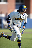 Michigan Wolverines designated hitter Jake Marti (7) runs to first base during the NCAA baseball game against the Illinois Fighting Illini at Fisher Stadium on March 19, 2021 in Ann Arbor, Michigan. Illinois won the game 7-4. (Andrew Woolley/Four Seam Images)