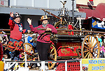 Fred and Edwina Wiersma ride on the Warren Engine Company entry in the 75th annual Nevada Day parade in Carson City, Nev., on Saturday, Oct. 26, 2013.<br /> Photo by Cathleen Allison