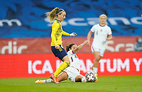 SOLNA, SWEDEN - APRIL 10: Carli Lloyd #10 of the United States reaching for a loose ball during a game between Sweden and USWNT at Friends Arena on April 10, 2021 in Solna, Sweden.