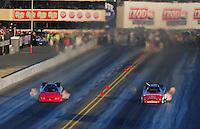 Jul. 29, 2011; Sonoma, CA, USA; NHRA funny car driver Gary Densham (left) races alongside Bob Tasca III during qualifying for the Fram Autolite Nationals at Infineon Raceway. Mandatory Credit: Mark J. Rebilas-