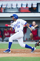 Christian Cano (30) of the Burlington Royals follows through on his swing against the Johnson City Cardinals at Burlington Athletic Park on July 14, 2014 in Burlington, North Carolina.  The Cardinals defeated the Royals 9-4.  (Brian Westerholt/Four Seam Images)